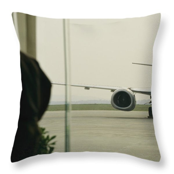 A Man At A Chinese Airport Walks Throw Pillow by Justin Guariglia