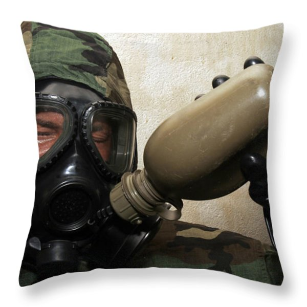 A Marine Drinks Water From A Canteen Throw Pillow by Stocktrek Images