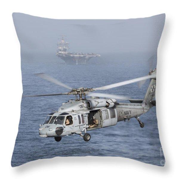 A Mh-60s Knighthawk Conducts A Vertical Throw Pillow by Gert Kromhout