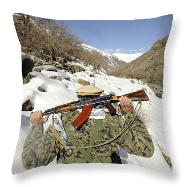A Mujahadeen Guard Walks With U.s Throw Pillow by Stocktrek Images