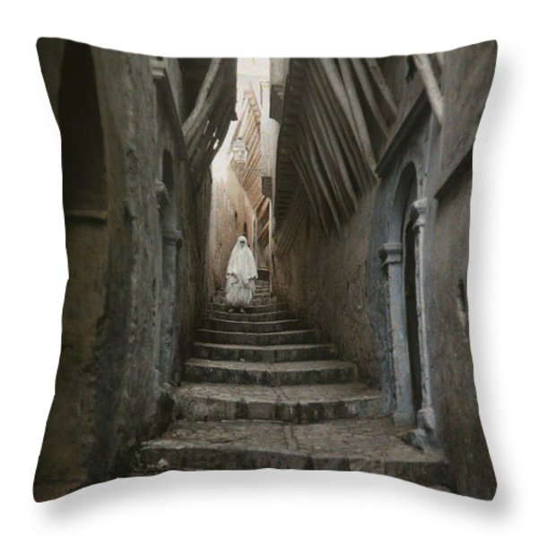 A Muslim Woman Walking Down A Steep Throw Pillow by Gervais Courtellemont