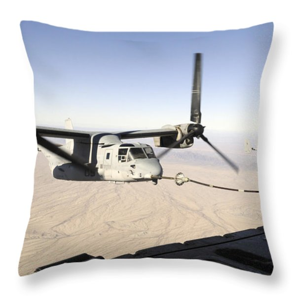 A Mv-22 Osprey Refuels Midflight While Throw Pillow by Stocktrek Images