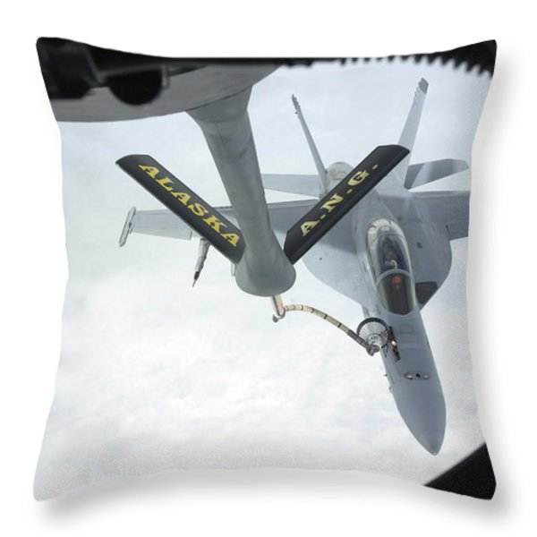 A Navy Fa-18f Super Hornet Is Refueled Throw Pillow by Stocktrek Images