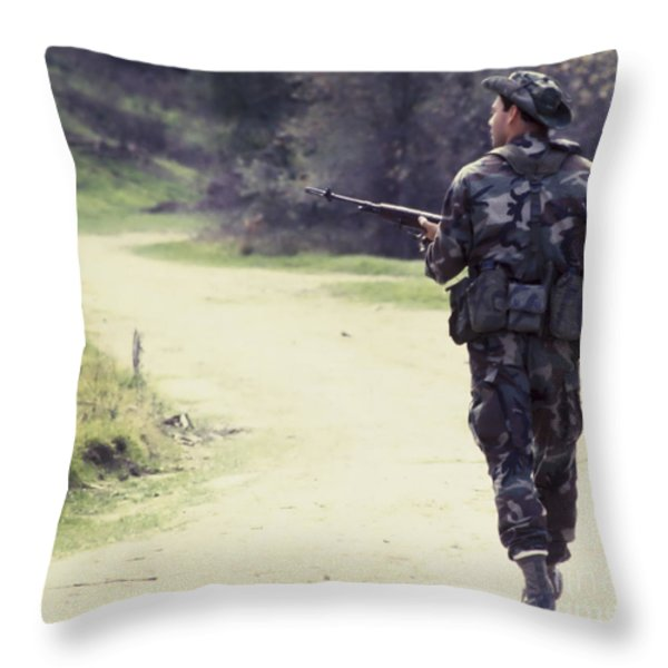 A Navy Seal Patrols Down The Road Throw Pillow by Michael Wood