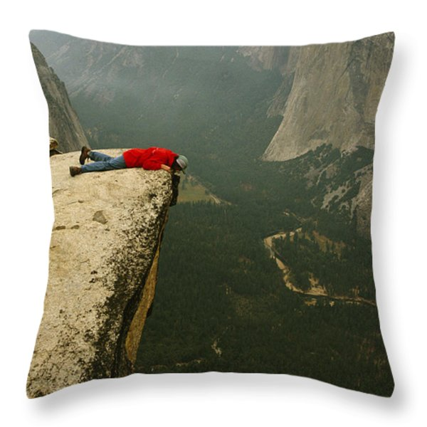 A Prone Man Peers Over Taft Point Throw Pillow by Bill Hatcher