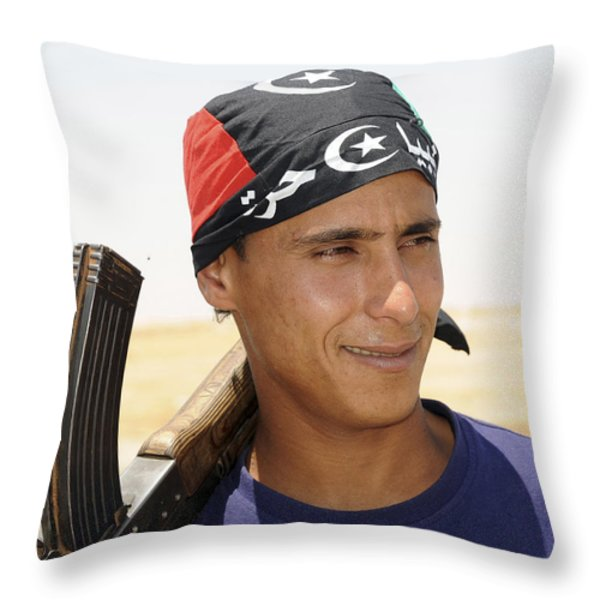 A Rebel Fighter With An Ak-47 Assault Throw Pillow by Andrew Chittock