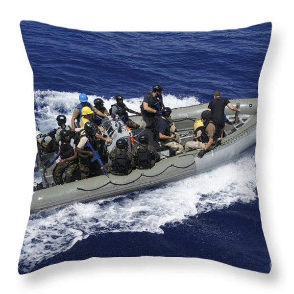 A Rigid-hull Inflatable Boat Carrying Throw Pillow by Stocktrek Images