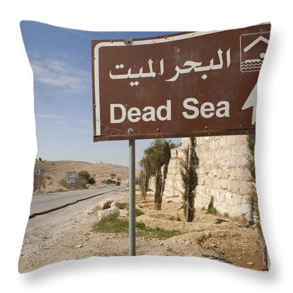 A Road Sign In Both Arabic And English Throw Pillow by Taylor S. Kennedy