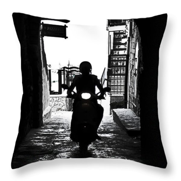a scooter rider in the back light in a narrow street in Italy Throw Pillow by Joana Kruse
