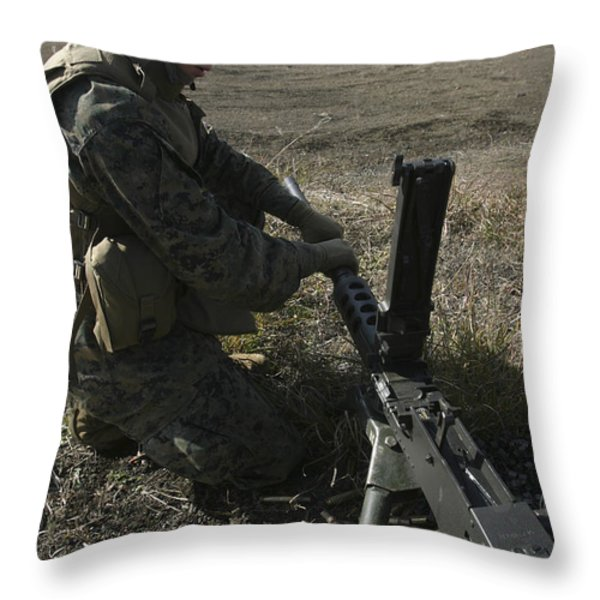 A Soldier Changes The Barrel Of An M2 Throw Pillow by Stocktrek Images