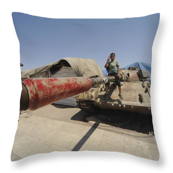 A T-55 Tank With Two Children Playing Throw Pillow by Andrew Chittock