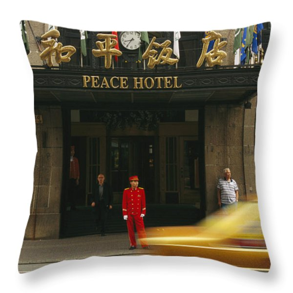 A Taxi Drives Past Shanghais Famous Throw Pillow by Justin Guariglia