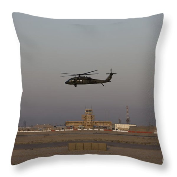 A Uh-60 Blackhawk Helicopter Flies Throw Pillow by Terry Moore