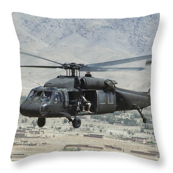 A Uh-60 Blackhawk Helicopter Throw Pillow by Stocktrek Images