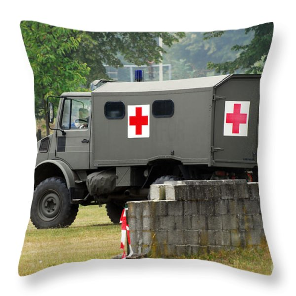 A Unimog In An Ambulance Version In Use Throw Pillow by Luc De Jaeger