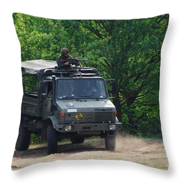 A Unimog Vehicle Of The Belgian Army Throw Pillow by Luc De Jaeger