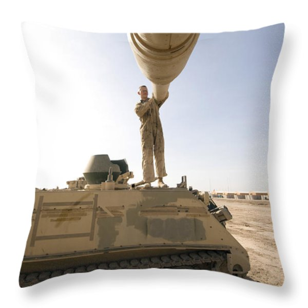 A Us Army Mechanic Uses A M113 Throw Pillow by Terry Moore