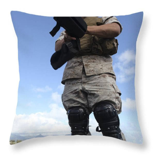 A U.s. Marine Dons Riot Gear For Drills Throw Pillow by Stocktrek Images