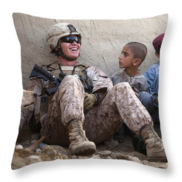 A U.s. Marine Jokes With Afghan Throw Pillow by Stocktrek Images