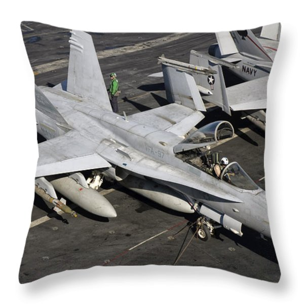 A Us Navy Fa-18c Hornet Parked Throw Pillow by Giovanni Colla