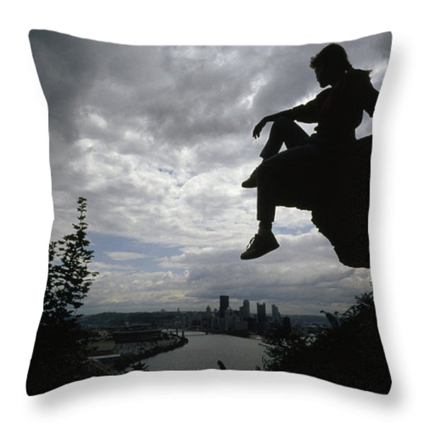 A Woman Perched On An Overlook Throw Pillow by Lynn Johnson