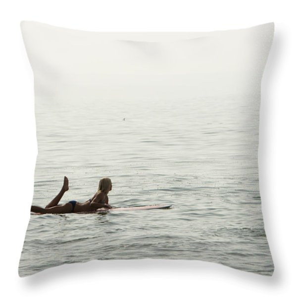 A Woman Rests On Her Surfboard Waiting Throw Pillow by Tim Davis