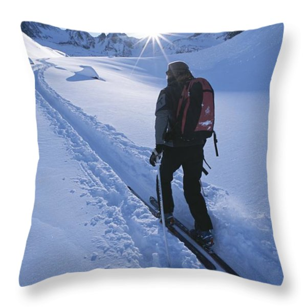 A Woman Skiing In The Selkirk Throw Pillow by Jimmy Chin