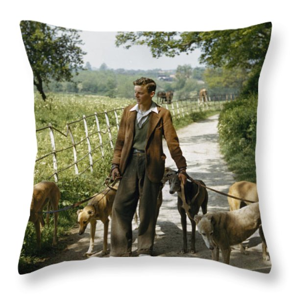 A Woman Talks With A Man Walking Racing Throw Pillow by B. Anthony Stewart