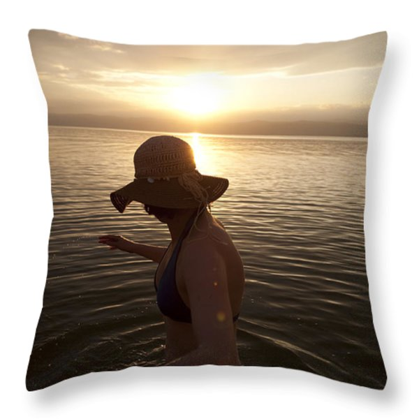 A Woman Wades Into The Dead Sea Throw Pillow by Taylor S. Kennedy