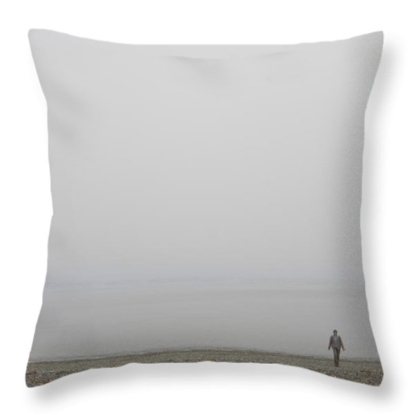 A Woman Walks Along The Beach Throw Pillow by Taylor S. Kennedy