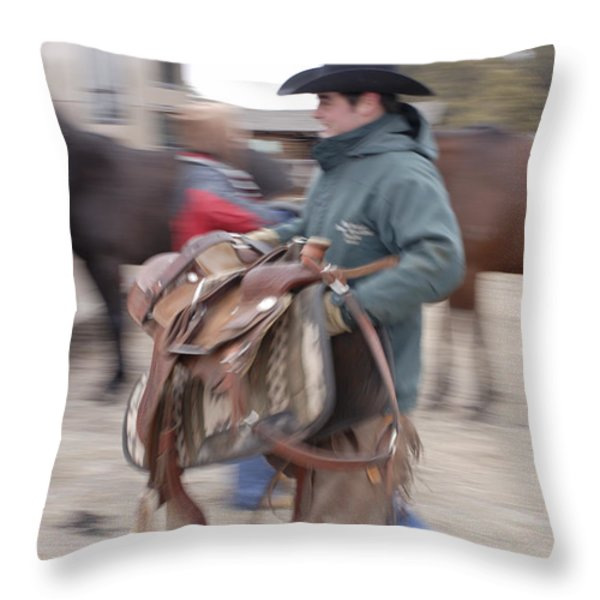 A Young Rancher Lifts A Throw Pillow by Joel Sartore
