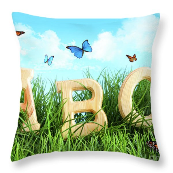 Abc Letters In The Grass Throw Pillow by Sandra Cunningham