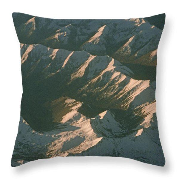 Aerial View Of Snowcapped Mountain Throw Pillow by Gordon Wiltsie
