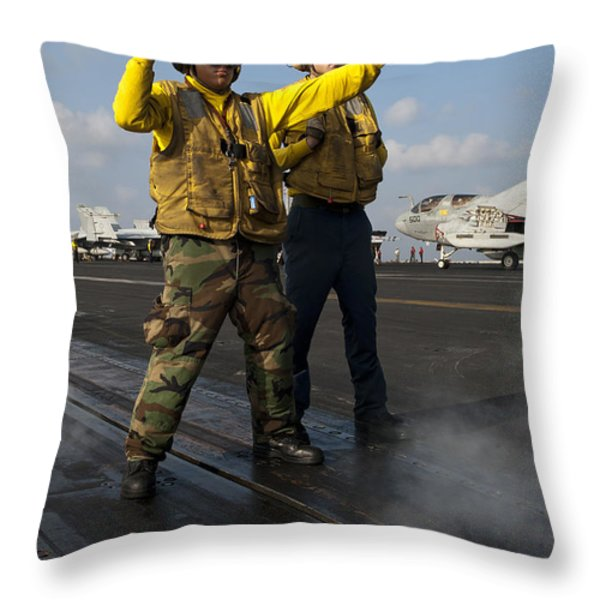 Airmen Direct An Fa-18c Hornet Throw Pillow by Stocktrek Images