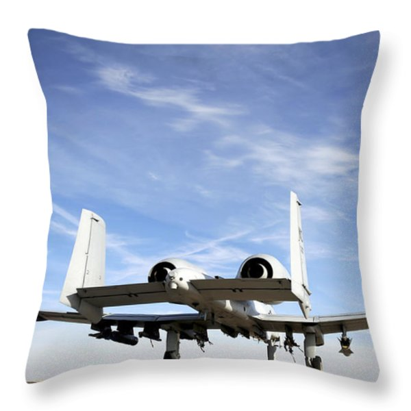 An A-10 Thunderbolt Ii Taxies Throw Pillow by Stocktrek Images