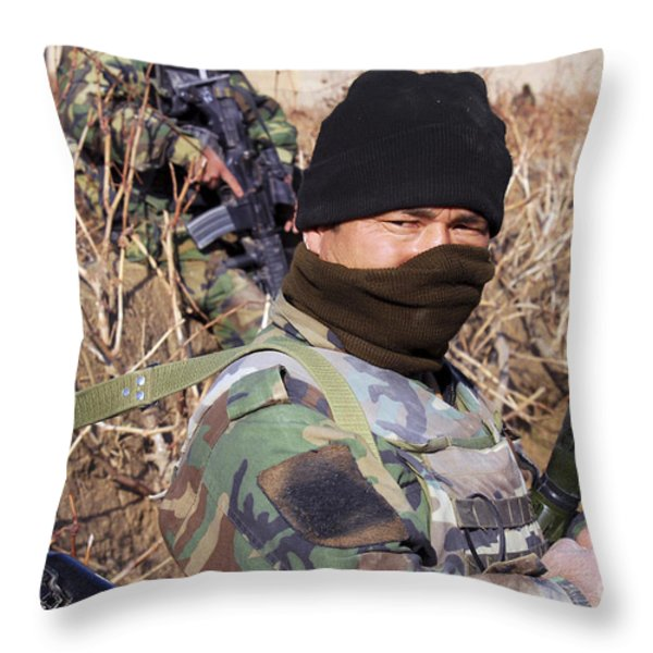 An Afghan Commando On Patrol Throw Pillow by Stocktrek Images