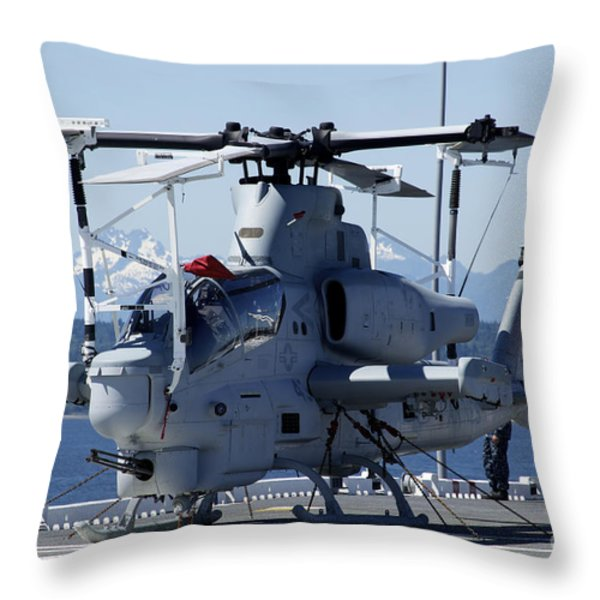 An Ah-1w Cobra Is Chained To The Flight Throw Pillow by Stocktrek Images