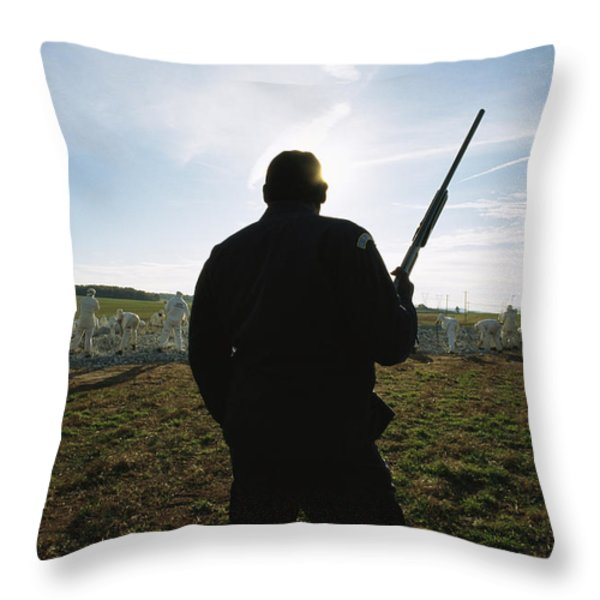 An Armed Guard Watches Over Inmates Throw Pillow by Bill Curtsinger