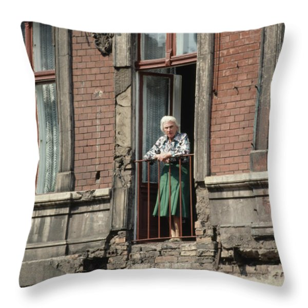 An Elderly Woman Stands At The Door Throw Pillow by Cotton Coulson
