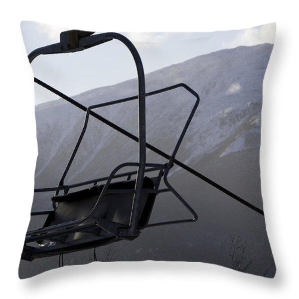 An Empty Chair Lift At A Ski Resort Throw Pillow by Tim Laman