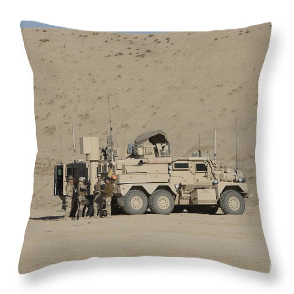 An Eod Cougar Mrap In A Wadi Throw Pillow by Terry Moore