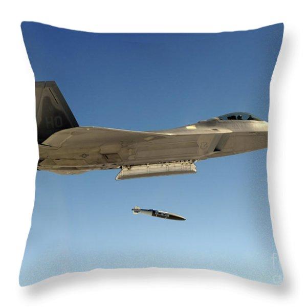 An F-22a Raptor Drops A Gbu-32 Bomb Throw Pillow by Stocktrek Images