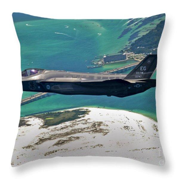 An F-35 Lightning Ii Flies Over Destin Throw Pillow by Stocktrek Images