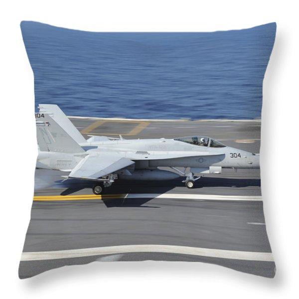 An Fa-18c Hornet Lands Aboard Uss Throw Pillow by Stocktrek Images