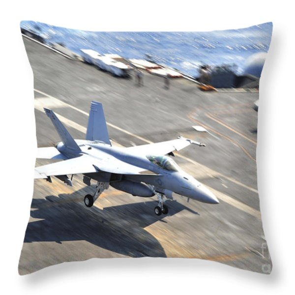 An Fa-18e Super Hornet Lands Aboard Throw Pillow by Stocktrek Images