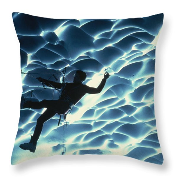 An Ice Climber Crosses The Ceiling Throw Pillow by Carsten Peter