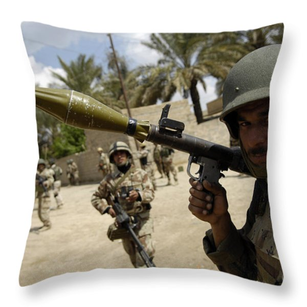 An Iraqi Army Soldier Provides Security Throw Pillow by Stocktrek Images