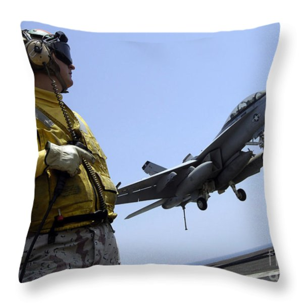 An Officer Observes An Fa-18f Super Throw Pillow by Stocktrek Images