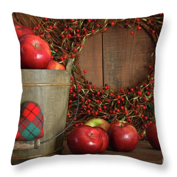 Apples In Wood Bucket For Holiday Baking Throw Pillow by Sandra Cunningham