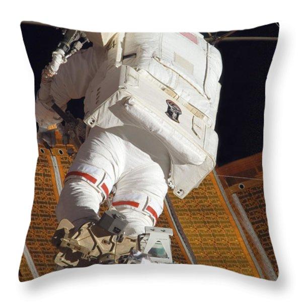 Astronaut Installs Stabilizers Throw Pillow by Stocktrek Images
